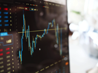 Blue and Yellow Graph on Stock Market Monitor Free Stock Photo