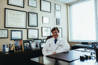 Doctor Sitting in Front of His Desk Free Stock Photo