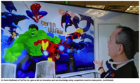 Dr. Karim Budhwani of CerFlux Inc. gave a talk on innovation and new knowledge using a superhero mural to make points. (contributed)