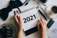Hands Holding a 2021 Calendar Free Stock Photo