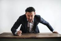 Mad formal executive man yelling at camera Free Stock Photo
