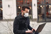 Man in Black Jacket Using Laptop Computer Free Stock Photo