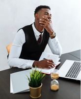 Man in Black Vest and White Dress Shirt Sitting on Chair Free Stock Photo