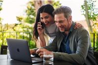 Man sitting beside woman looking at laptop photo Free Dating Image on Unsplash