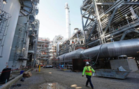 In this Nov. 16, 2015 file photo, a worker walks through a section of the Mississippi Power Co. carbon capture plant in DeKalb, Miss.  Rogelio V. Solis   AP