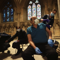 Churches like Lichfield Cathedral near Birmingham, England, have been turned into vaccination hubs. CARL RECINE/REUTERS