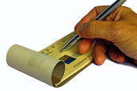 checkbook with pen writing check