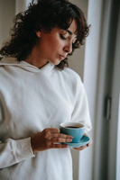 Woman concerned drinking cup of coffee