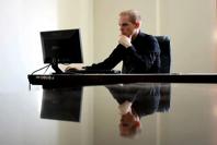 Entrepreneur sitting at a desk.