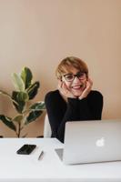 Entrepreneur - Woman sitting behind a laptop.