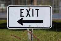 exit sign with an arrow pointing left