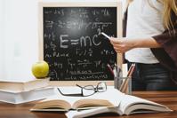 Chalkboard with e=mc2 on it.