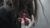 trends - red finger spinner