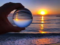Sunrise through a crystal lensball looking to a br 373WPUV