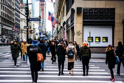 City Street with people walking on a crosswalk