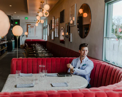 Venture Capital - Person sitting in restaurant booth