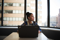 Woman Sits in Front of Black Laptop Computer Free Stock Photo