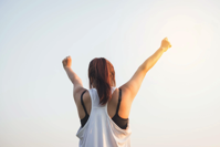 Woman Wearing Black Bra and White Tank Top Raising Both Hands on Top Free Stock Photo