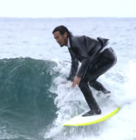 A wetsuit that s an actual suit is the most stylish thing to happen to surfing
