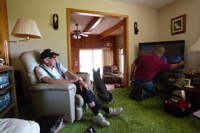 Green Bank, W.Va., resident Alfred Ervine watches a technician hook up his new Internet and TV service. David Kidd