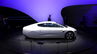 A Volkswagen XL1 hybrid Photograph by Jason Lee — Reuters